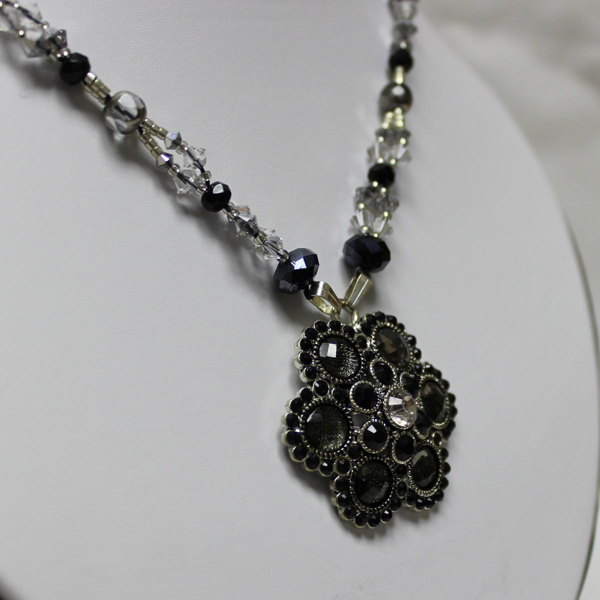 crystal statement necklace, flower charm center, hematite crystals, silver accent necklace