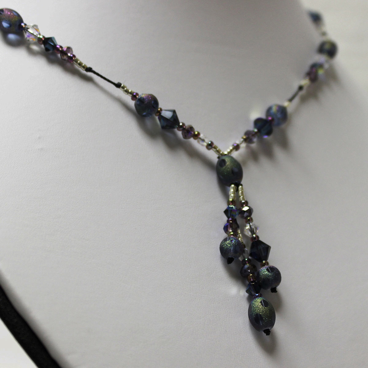 triple drop necklace, oval stardust beads, olivine green crystals, amethyst crystals, clear crystals